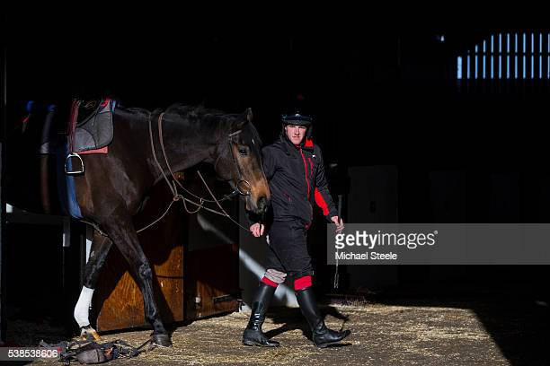 Chris Davies leads Perform out of the stables at Sandhill Racing Stables on November 23 2015 in Minehead England Sandhill Racing Stables set in 500...