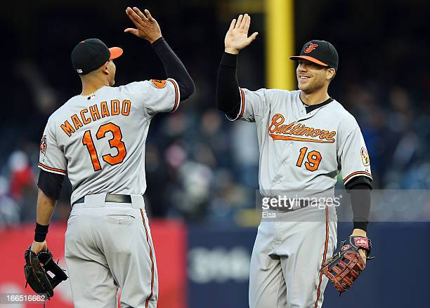 Chris Davis and Manny Machado of the Baltimore Orioles celebrate the win over the New York Yankees on April 13 2013 at Yankee Stadium in the Bronx...