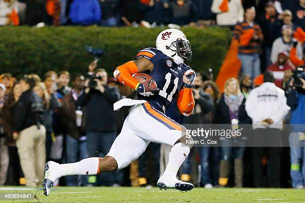 Chris Davis of the Auburn Tigers returns a missed field goal for the winning touchdown in their 34 to 28 win over the Alabama Crimson Tide at...