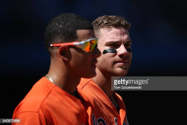 Chris Davis of the Baltimore Orioles and Manny Machado relax at third base during a pitching change in the eighth inning during MLB game action...
