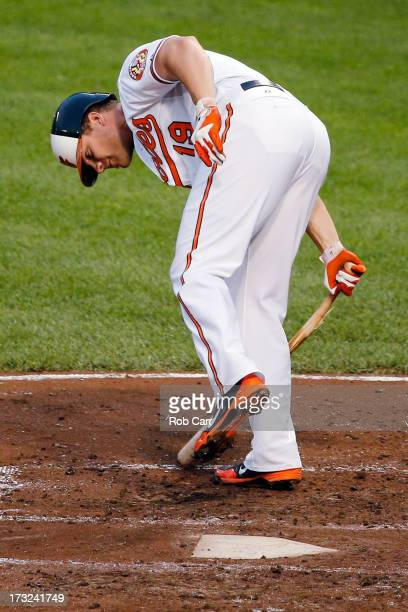 Chris Davis of the Baltimore Orioles breaks his bat after striking out for the third out of the third inning against the Texas Rangers at Oriole Park...