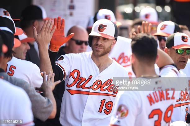 Chris Davis of the Baltimore Orioles celebrates a solo home run in the eighth inning during a baseball game against the Seattle Mariners at Oriole...