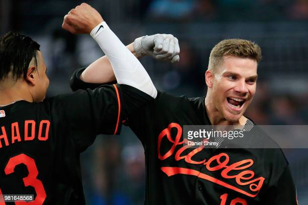 Chris Davis of the Baltimore Orioles celebrates a solo home run with Manny Machado during the fifth inning against the Atlanta Braves at SunTrust...
