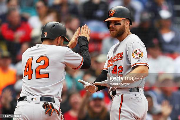 Chris Davis of the Baltimore Orioles celebrates with Renato Nunez after hitting a two run home run against the Boston Red Sox during the eighth...
