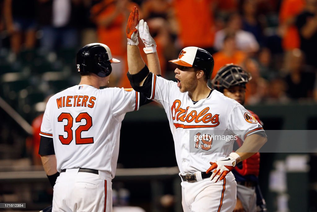 Chris Davis #19 of the Baltimore Orioles celebrates with teammate Matt Wieters #32 after Davis hit a two RBI home run in the seventh inning of the Orioles 6-3 win over the Cleveland Indians at Oriole Park at Camden Yards on June 25, 2013 in Baltimore, Maryland.
