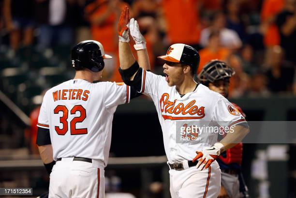 Chris Davis of the Baltimore Orioles celebrates with teammate Matt Wieters after Davis hit a two RBI home run in the seventh inning of the Orioles 63...