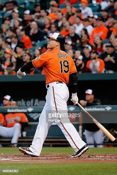 Chris Davis of the Baltimore Orioles follows his solo home run against the Toronto Blue Jays in the first inning at Oriole Park at Camden Yards on...