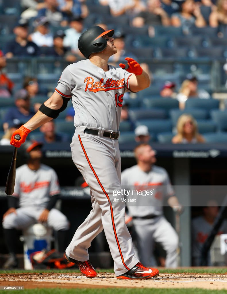 Chris Davis #19 of the Baltimore Orioles follows through on a second inning double against the New York Yankees at Yankee Stadium on September 17, 2017 in the Bronx borough of New York City.