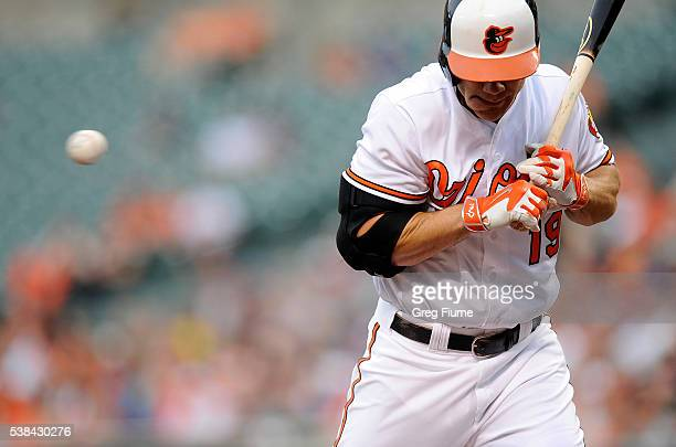 Chris Davis of the Baltimore Orioles gets hit by a pitch in the second inning against the Kansas City Royals at Oriole Park at Camden Yards on June 6...
