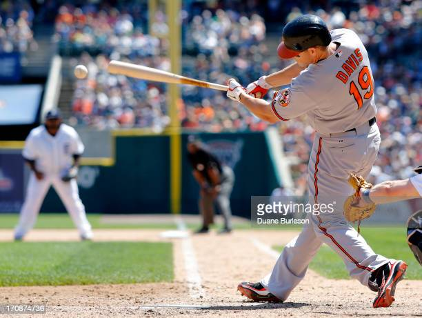 Chris Davis of the Baltimore Orioles hits a groundrule double against the Detroit Tigers that drove in Manny Machado in the seventh inning at...