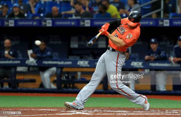 Chris Davis of the Baltimore Orioles hits a single in the third inning during game two of a doubleheader against the Tampa Bay Rays at Tropicana...
