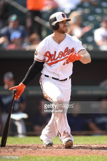 Chris Davis of the Baltimore Orioles hits a solo home run in the eighth inning during a baseball game against the Seattle Mariners at Oriole Park at...