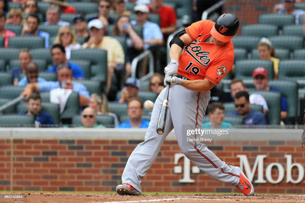 Chris Davis #19 of the Baltimore Orioles hits a three RBI double during the fifth inning against the Atlanta Braves at SunTrust Park on June 23, 2018 in Atlanta, Georgia.