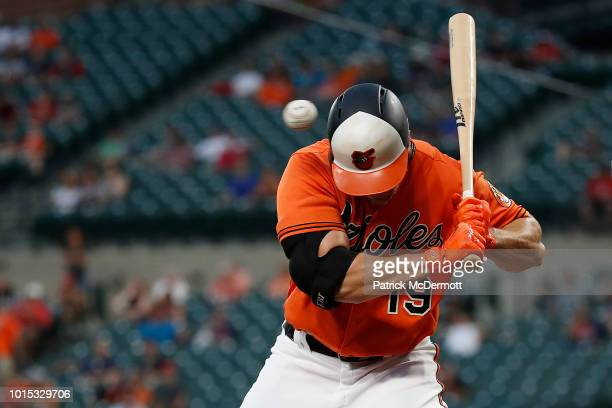 Chris Davis of the Baltimore Orioles is hit by a pitch thrown by Hector Velazquez of the Boston Red Sox in the second inning during game two of a...