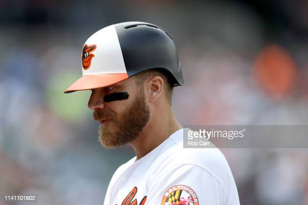 Chris Davis of the Baltimore Orioles looks on after flying out for first out of the third inning against the New York Yankees at Oriole Park at...