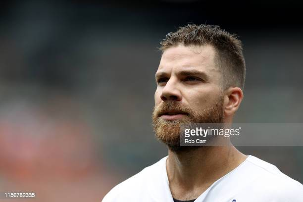 Chris Davis of the Baltimore Orioles looks on after flying out for the third out of the second inning against the Boston Red Sox at Oriole Park at...
