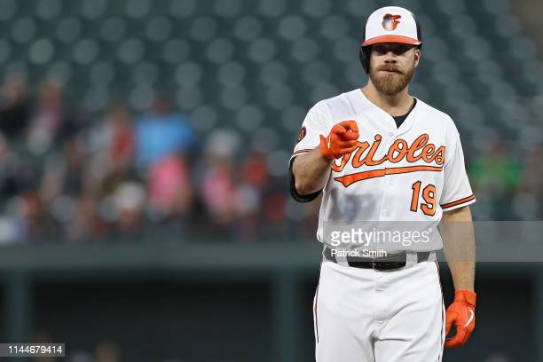 Chris Davis of the Baltimore Orioles looks on after reaching second base on a throwing error against the Chicago White Sox during the second inning...