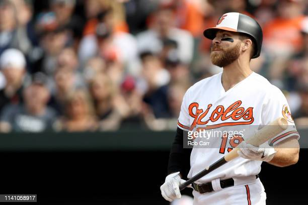 Chris Davis of the Baltimore Orioles looks on after striking out in the seventh inning against the New York Yankees at Oriole Park at Camden Yards on...