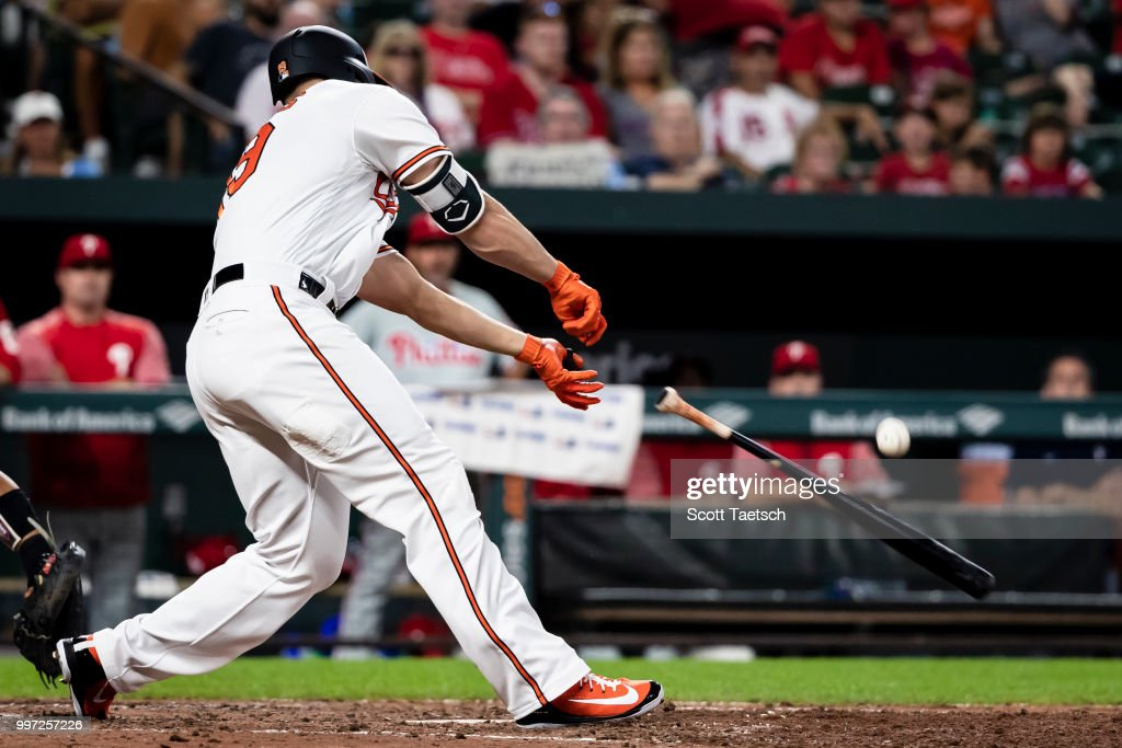 Chris Davis #19 of the Baltimore Orioles loses his bat against the Philadelphia Phillies during the eighth inning at Oriole Park at Camden Yards on July 12, 2018 in Baltimore, Maryland.