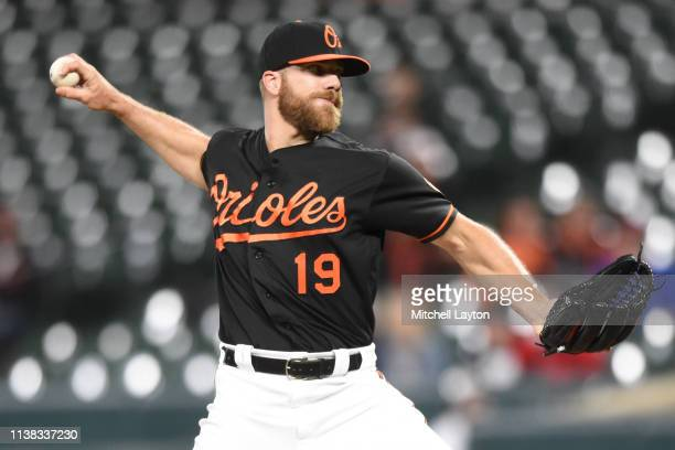 Chris Davis of the Baltimore Orioles pitches in the ninth inning during game two of a doubleheader baseball game against the Minnesota Twins at...