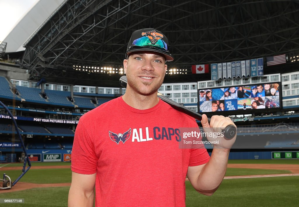 Chris Davis #19 of the Baltimore Orioles poses in batting practice while wearing a Washington Capitals shirt ahead of Game 5 of the Stanley Cup Finals prior to MLB game action against the Toronto Blue Jays at Rogers Centre on June 7, 2018 in Toronto, Canada.