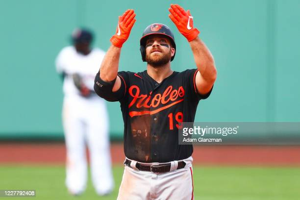 Chris Davis of the Baltimore Orioles reacts after hitting an RBI double in the ninth inning of a game against the Boston Red Sox at Fenway Park on...