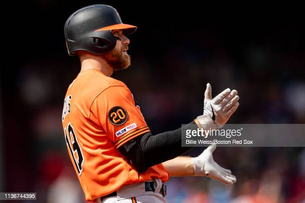 Chris Davis of the Baltimore Orioles reacts after hitting an RBI single during the first inning of a game against the Boston Red Sox on April 13 2019...