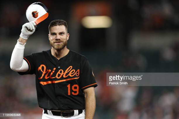 Chris Davis of the Baltimore Orioles reacts after popping out against the Boston Red Sox during the fourth inning at Oriole Park at Camden Yards on...