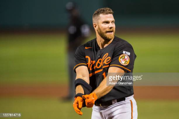 Chris Davis of the Baltimore Orioles reacts after striking out during the game between the Baltimore Orioles and the Boston Red Sox at Fenway Park on...