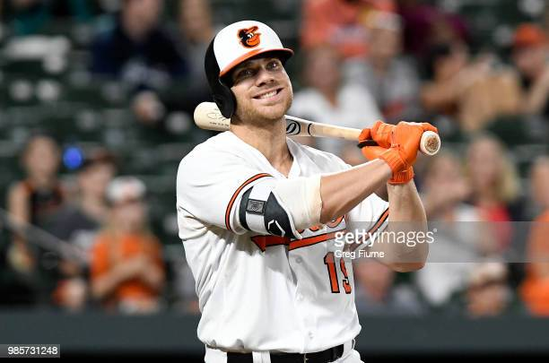 Chris Davis of the Baltimore Orioles reacts after striking out in the eleventh inning against the Seattle Mariners at Oriole Park at Camden Yards on...