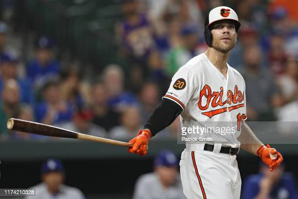 Chris Davis of the Baltimore Orioles reacts as he bats against the Los Angeles Dodgers at Oriole Park at Camden Yards on September 11, 2019 in...