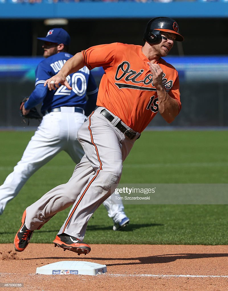 Chris Davis #19 of the Baltimore Orioles rounds third base and heads home to score a run on an RBI single by Caleb Joseph #36 in the seventh inning during MLB game action against the Toronto Blue Jays on September 5, 2015 at Rogers Centre in Toronto, Ontario, Canada.