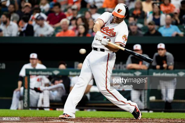 Chris Davis of the Baltimore Orioles singles against the Washington Nationals during the second inning at Oriole Park at Camden Yards on May 30 2018...
