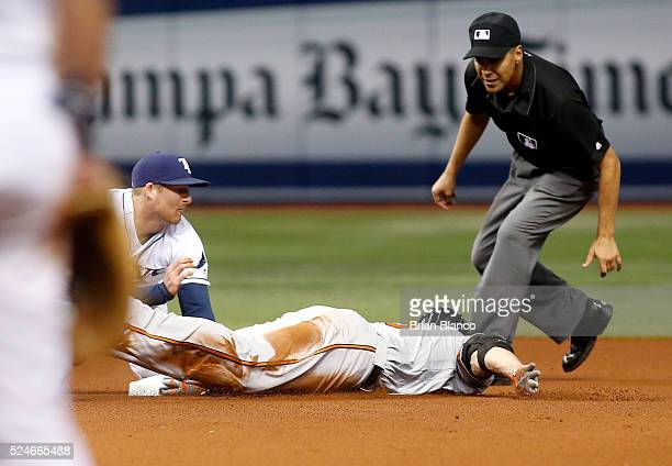 Chris Davis of the Baltimore Orioles slides safely into second base ahead of shortstop Brad Miller of the Tampa Bay Rays on his double during the...