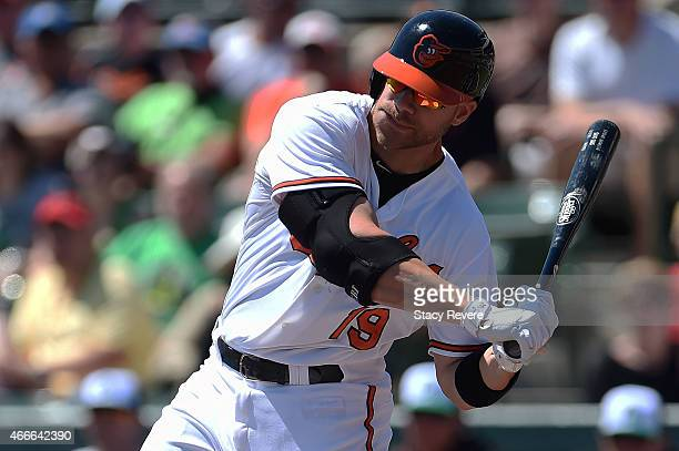 Chris Davis of the Baltimore Orioles swings at a pitch during a spring training game against the Minnesota Twins at Ed Smith Stadium on March 17 2015...