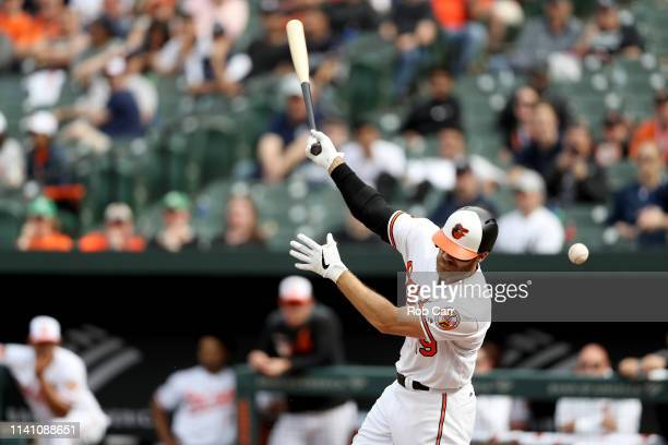 Chris Davis of the Baltimore Orioles swings at a pitch in the seventh inning against the New York Yankees at Oriole Park at Camden Yards on April 07...