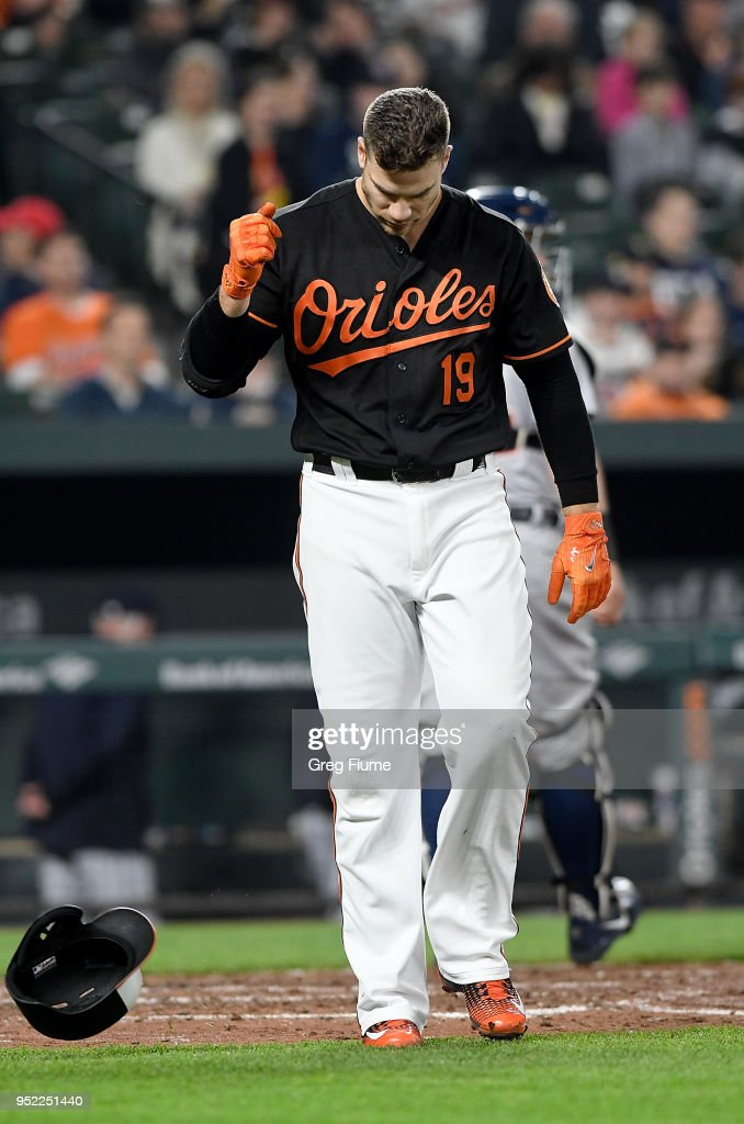 Chris Davis #19 of the Baltimore Orioles tosses his helmet after striking out in the sixth inning against the Detroit Tigers at Oriole Park at Camden Yards on April 27, 2018 in Baltimore, Maryland.