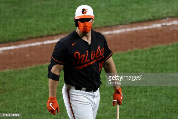 Chris Davis of the Baltimore Orioles walks back to the dugout after striking out looking for the second out of the seventh inning against the Tampa...