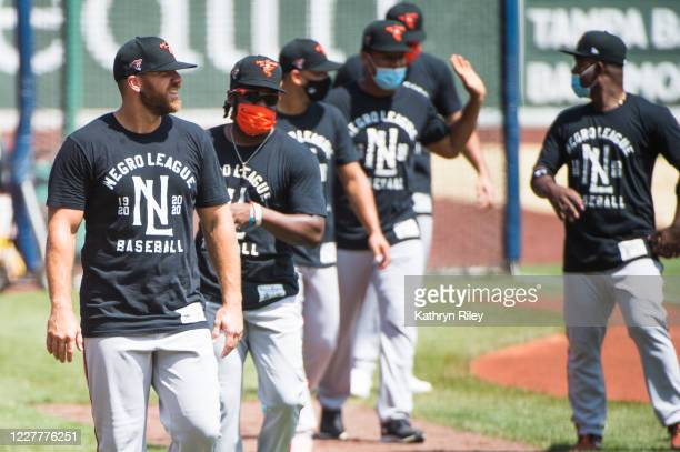 Chris Davis of the Baltimore Orioles wears a t shirt honoring the Negro League during batting practice prior to the start of the game against the...