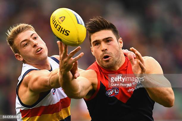 Chris Dawes of the Demons attempts to mark infront of Daniel Talia of the Crows during the round 15 AFL match between the Melbourne Demons and the...