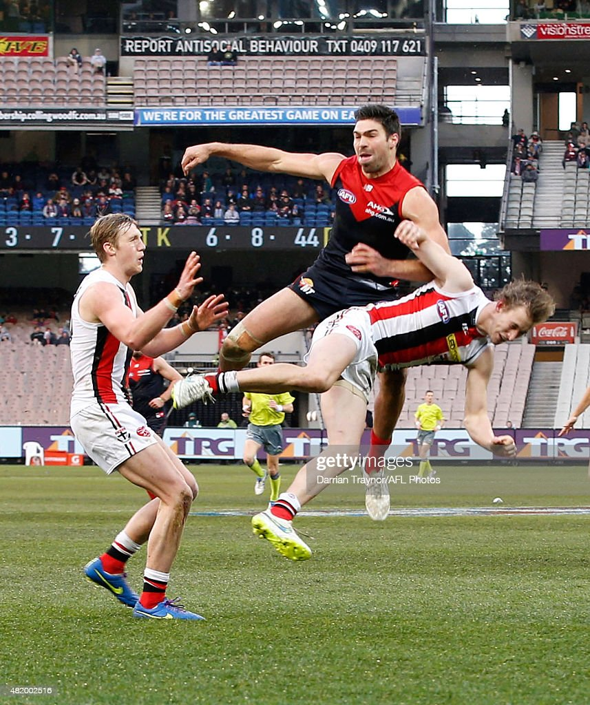 Chris Dawes of the Demons crashes into Jimmy Webster of the Saints during the round 17 AFL match between the Melbourne Demons and the St Kilda Saints at Melbourne Cricket Ground on July 26, 2015 in Melbourne, Australia.