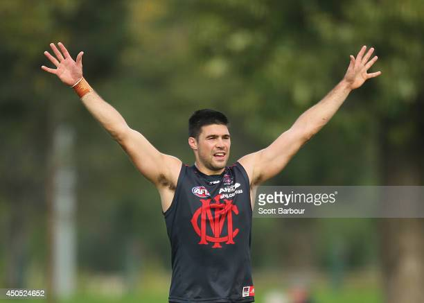 Chris Dawes of the Demons gestures for the ball during a Melbourne Demons AFL training session at Gosch's Paddock on June 13, 2014 in Melbourne,...