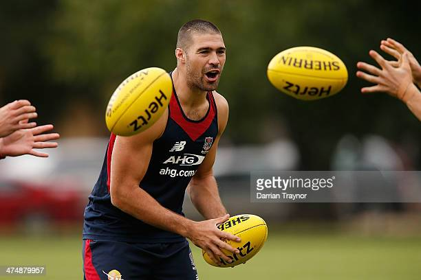 Chris Dawes takes part in handball drills during a Melbourne Demons training session at Gosch's Paddock on February 26, 2014 in Melbourne, Australia.