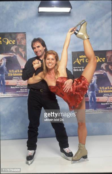"""Chris de Burgh and Denise Biellmann in front of """"Art on Ice"""" poster 1998"""