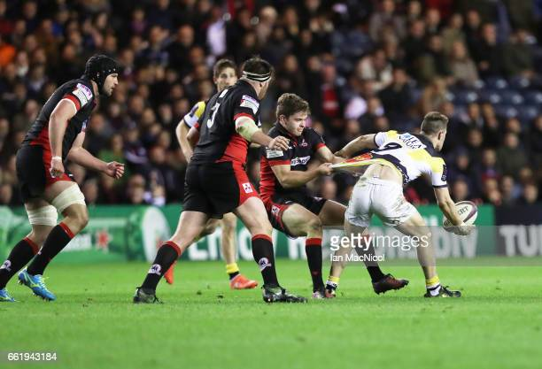 Chris Dean of Edinburgh tackles Arthur Retiere of La Rochelle during The European Challenge Cup match between Edinburgh and La Rochelle at...