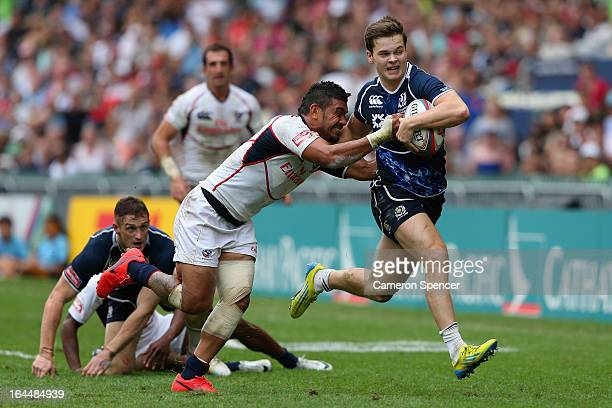 Chris Dean of Scotland is tackled during the Bowl Quarter Final match between Scotland and the United States during day three of the 2013 Hong Kong...