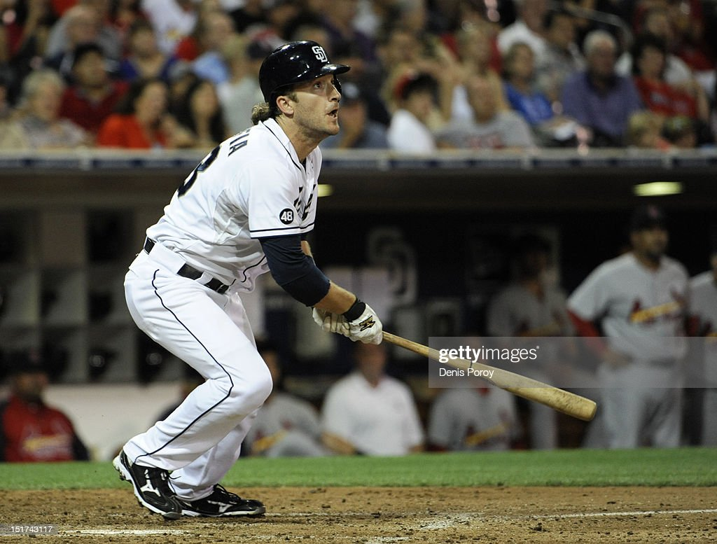 Chris Denorfia #13 of the San Diego Padres hits a double during the fourth inning of a baseball game against the St. Louis Cardinals at Petco Park on September 10, 2012 in San Diego, California.
