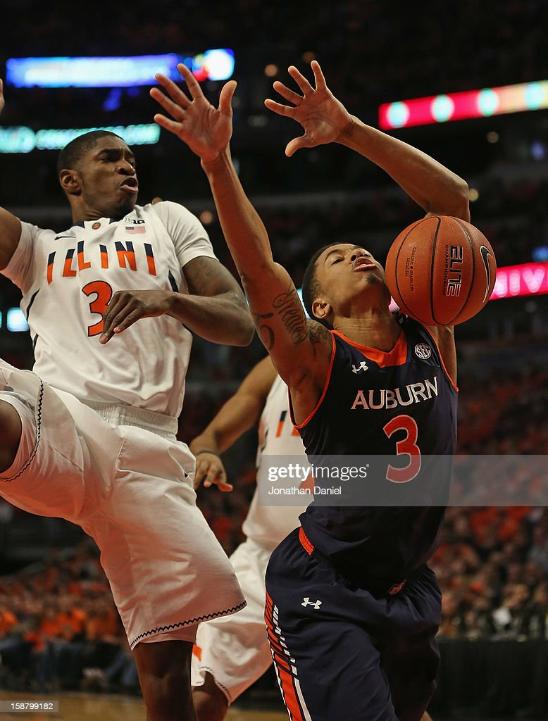 Chris Denson #3 of the Auburn Tigers looses control of the ball under pressure from Brandon Paul #3 of the Illinois Fighting Illini at United Center on December 29, 2012 in Chicago, Illinois.