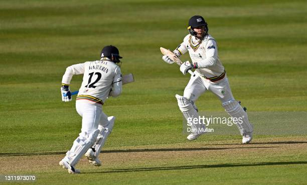 Chris Dent and Graeme van Buuren of Gloucestershire score runs during day four of the LV= County Championship match between Gloucestershire and...