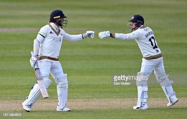 Chris Dent and Graeme van Buuren of Gloucestershire touch gloves during day four of the LV= County Championship match between Gloucestershire and...